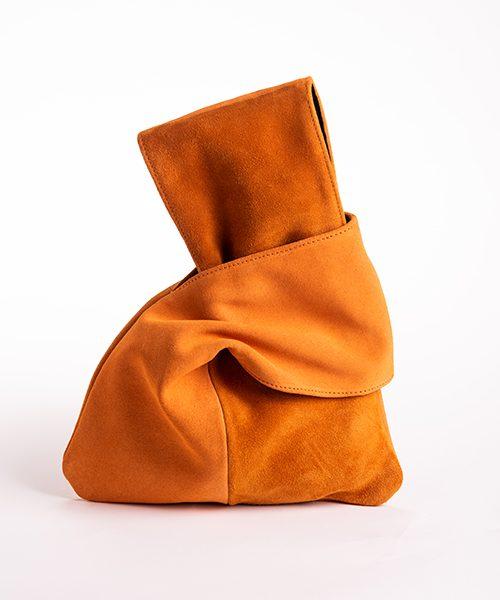 Pochette Kyo da polso in vera pelle, colore arancione.