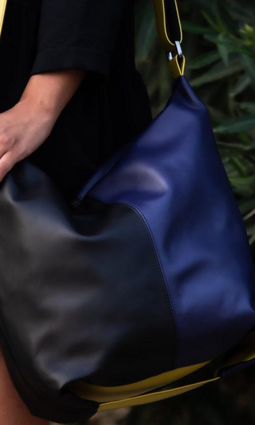 Borsa Azy con tracolla regolabile, in vera pelle colore nero, blu e verde. Made in Italy